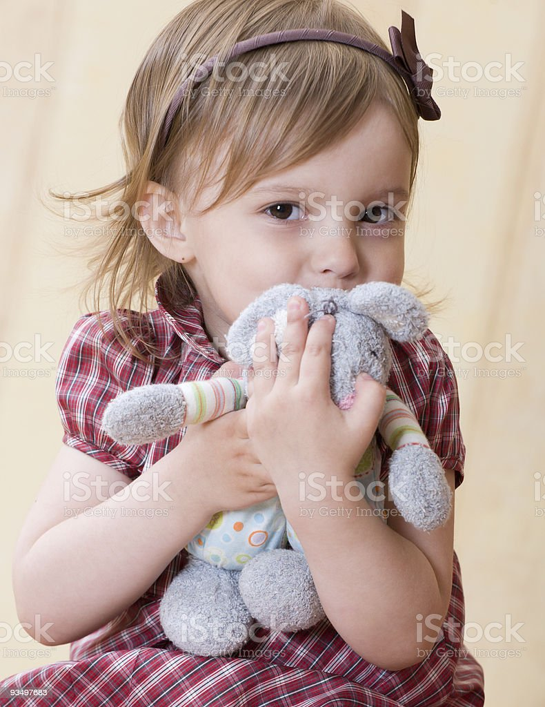 Little girl clasp toy rabbit to one's bosom royalty-free stock photo