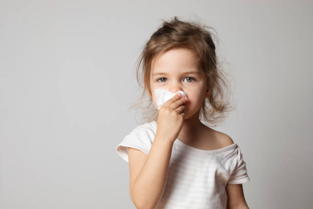 Little Girl Cleaning Her Nose stock photo