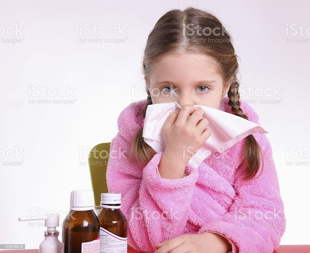 Little girl cleaning nose stock photo