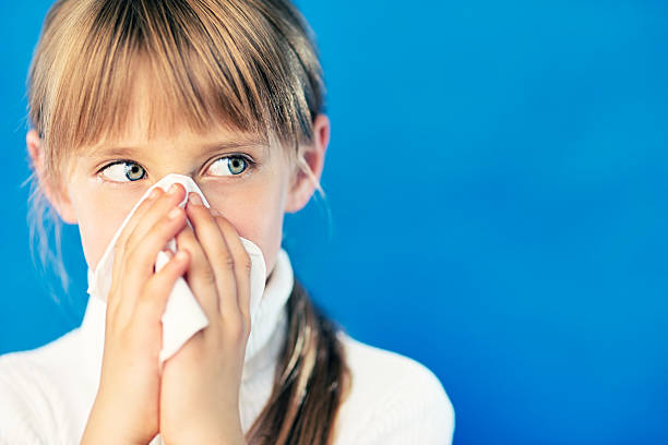 Little girl cleaning nose  human nose stock pictures, royalty-free photos & images
