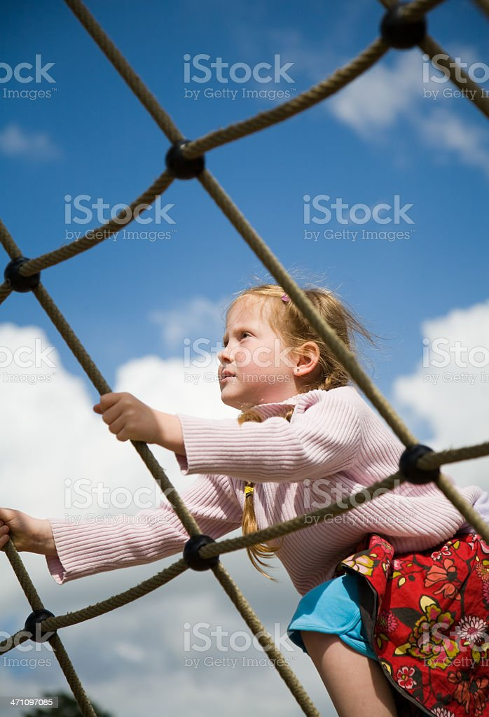 Little girl climbing a net - Royalty-free 4-5 Years Stock Photo