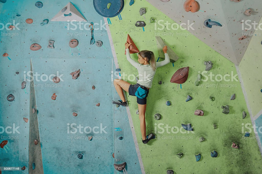 Little girl climbing in gym stock photo