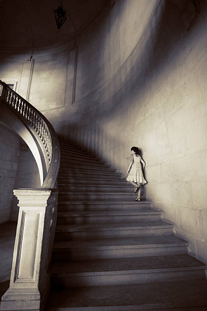 Little girl climbing staircase Little girl upstairs in a classical building. Alhambra, Granada, Spain. palace of charles v stock pictures, royalty-free photos & images