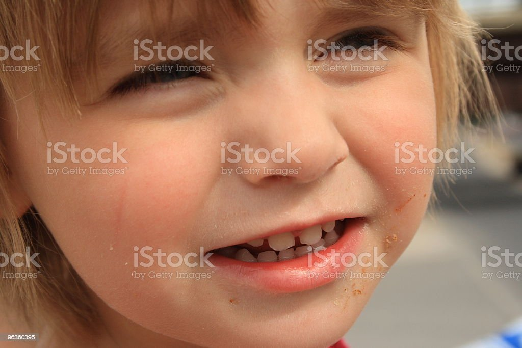 little girl close-up squints - dirty face royalty-free stock photo