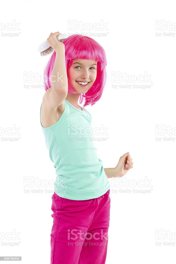 Little girl combing pink hair stock photo