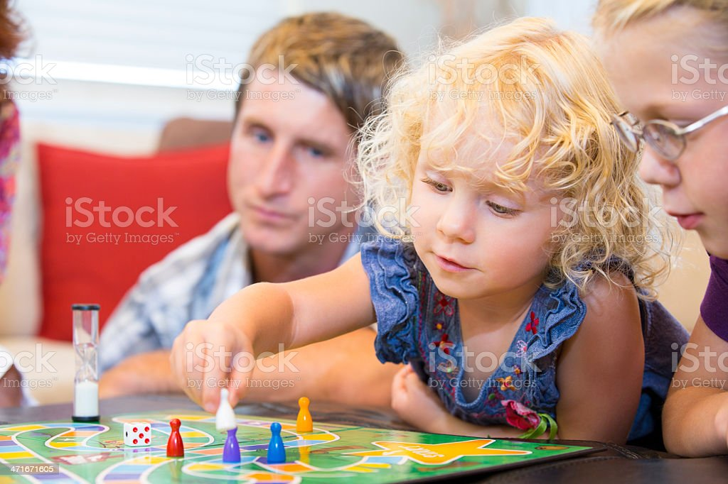 Little girl contemplating her next game move royalty-free stock photo