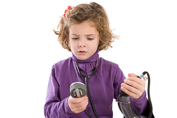 Little girl controlling her blood pressure stock photo