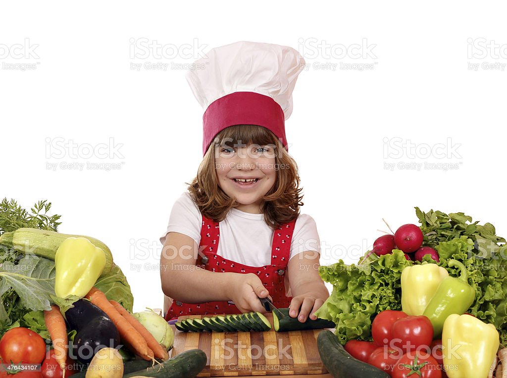 little girl cook cutting cucumber royalty-free stock photo