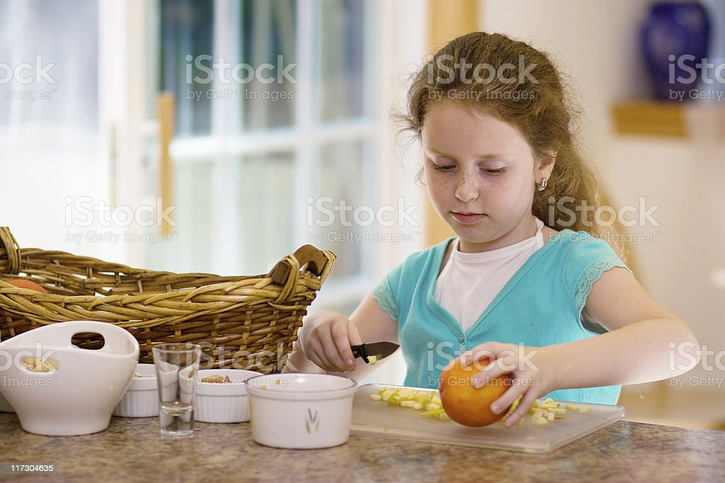 Little girl cook the fruit salad royalty-free stock photo