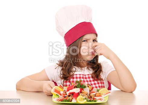 istock little girl cook with seafood bad smell 520842204