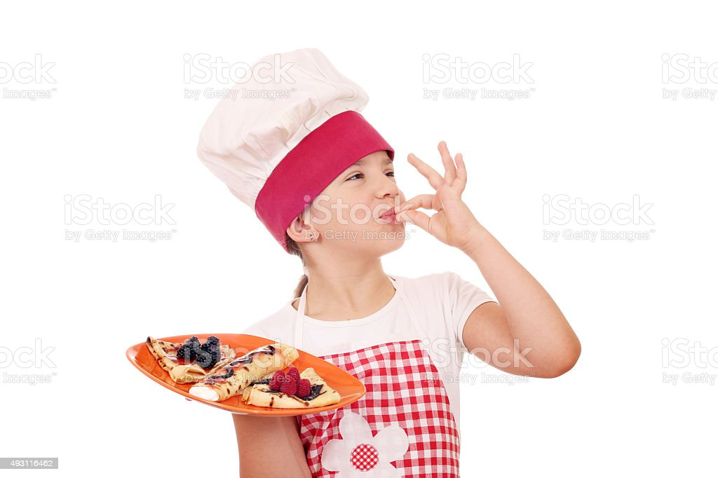 little girl cook with sweet crepes and ok hand sign stock photo