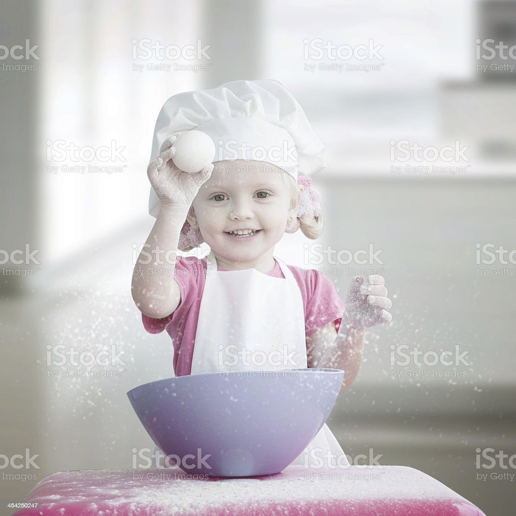Little girl cooking cakes royalty-free stock photo