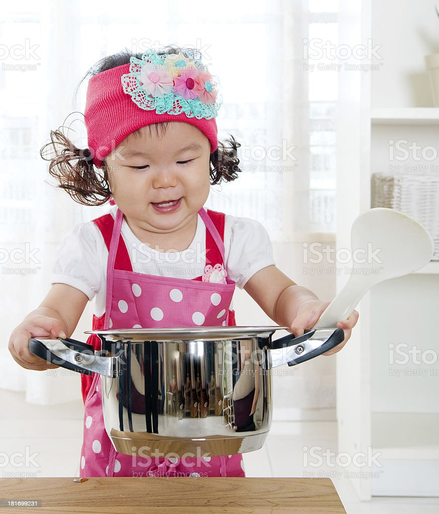 little girl cooking royalty-free stock photo