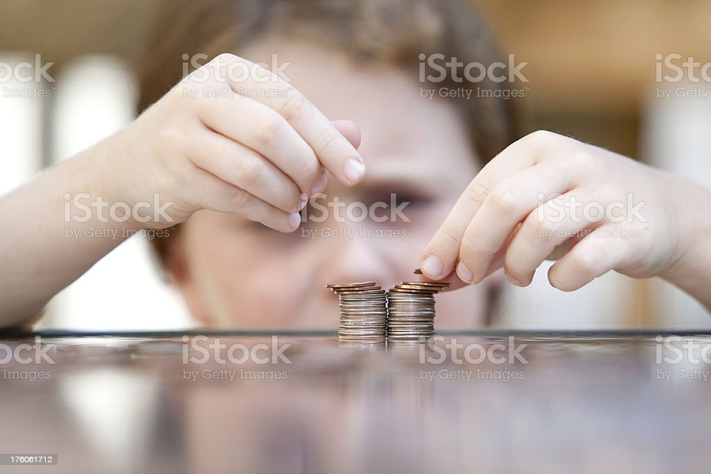 little girl counting coins stock photo