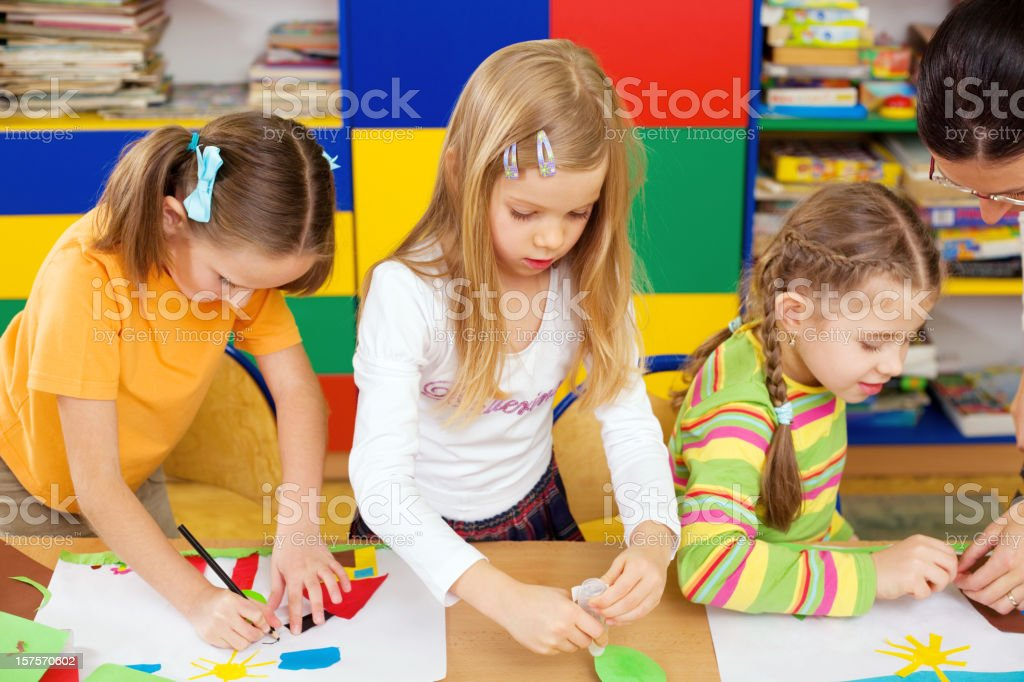 Little Girl Creating Collages In Class royalty-free stock photo