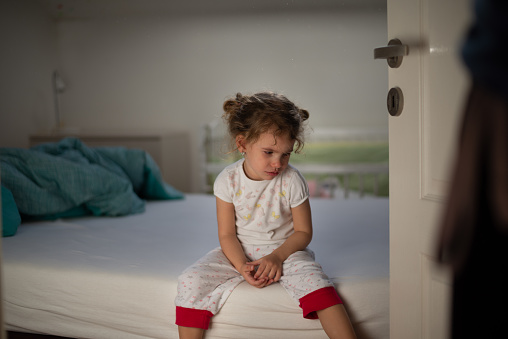 istock Little girl crying in bedroom 1133526032