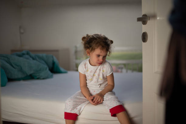 little girl crying in bedroom - child abuse stock pictures, royalty-free photos & images