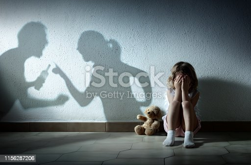 Little Girl Crying With Shadow Of Parents Arguing - Home Violence And Divorce