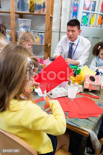 544351868 istock photo Little Girl Cutting Paper 544351582
