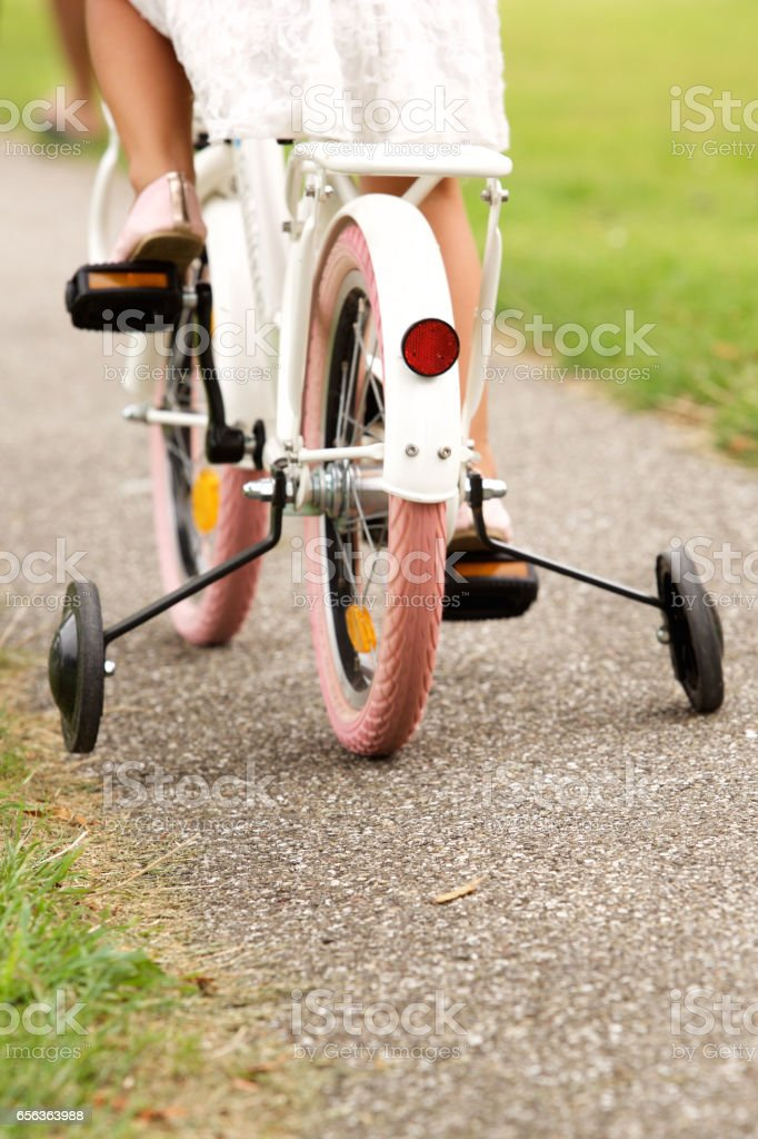 Little girl cycling in park stock photo