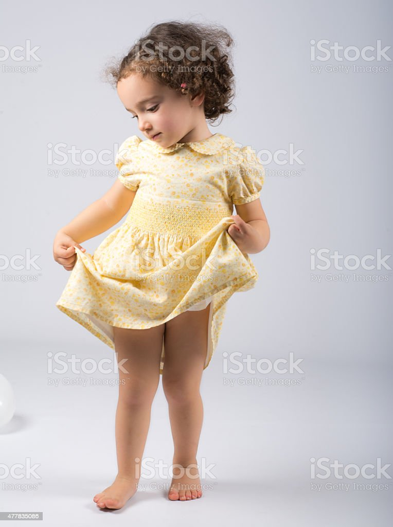 little girl dacing with sweet expression stock photo