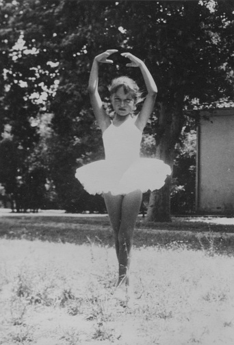 Little Girl Dancing in a Park, 1958. Black And White.