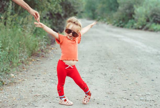 Little girl dancing in glasses picture id1176485576?b=1&k=6&m=1176485576&s=612x612&w=0&h=cikid4cblaz0hhov8q57jxcogn jfnzt0uislzib5si=
