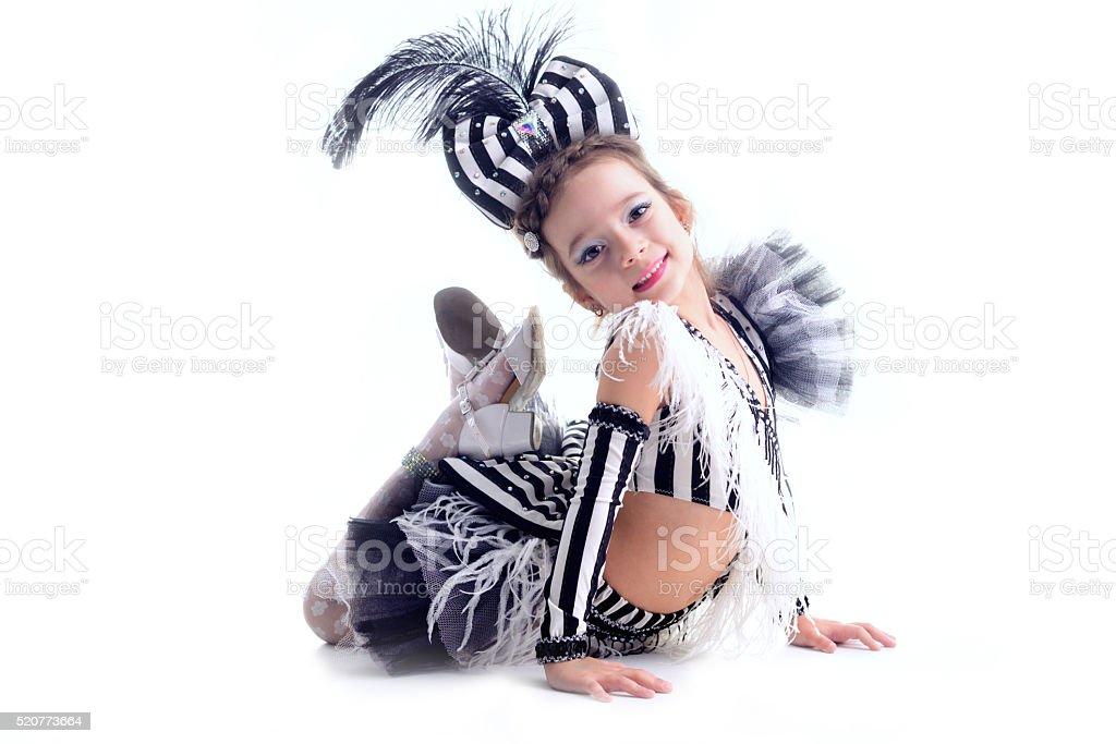 little girl dancing in the dress in the studio stock photo
