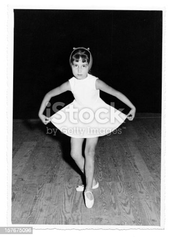 istock Little Girl Dancing on Stage in 1958.Black And White. 157675096
