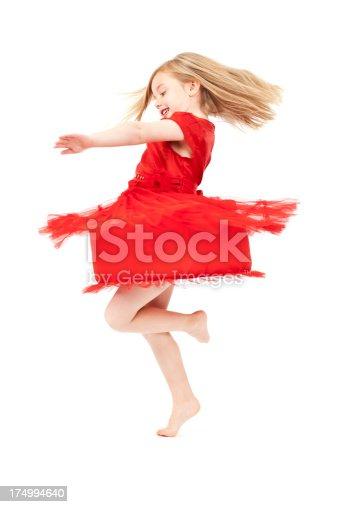LIttle girl spinning round. Some motion blur