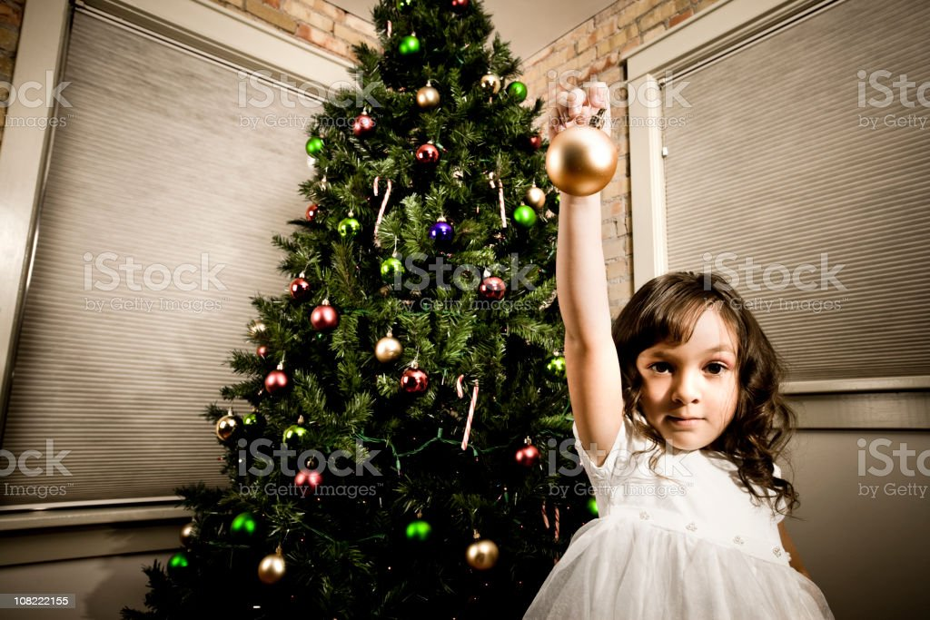 Little Girl Decorating Christmas Tree royalty-free stock photo