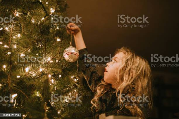Little girl decorating christmas tree with ornaments picture id1083952230?b=1&k=6&m=1083952230&s=612x612&h= wlbckyt0hxjglfucyprrnnrp fxevq go6uoz4nk4u=