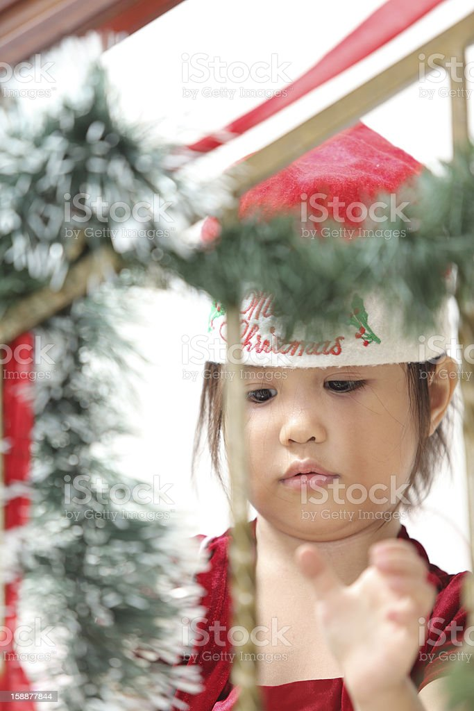 Little Girl Decorating For Christmas royalty-free stock photo