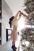 5 years old lLittle girl decoration christmas tree