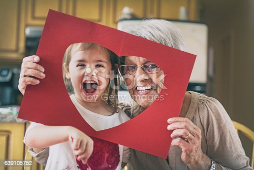 istock Little girl doing bricolage with grandmother 639105752