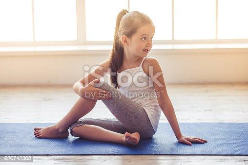 istock Little girl doing sport 620742308