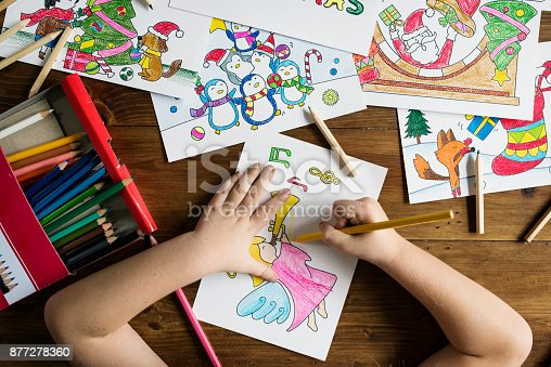 istock Little girl drawing and coloring 877278360