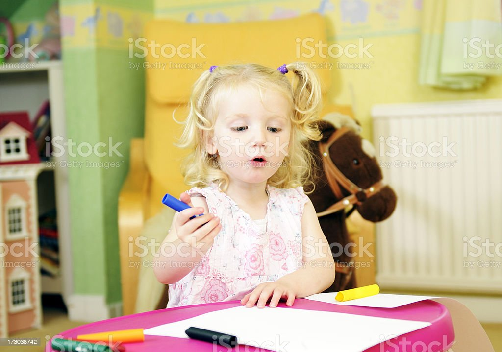 little girl drawing in her bedroom royalty-free stock photo