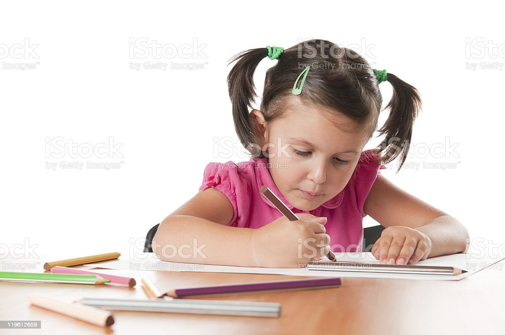 Little girl drawing pictures stock photo