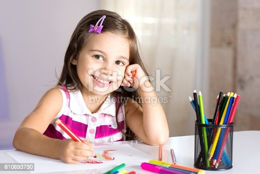 istock Little Girl Drawing Pictures 610693730