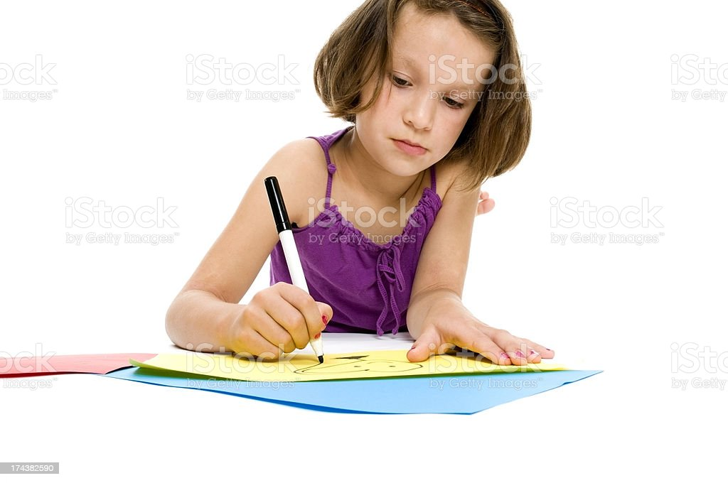 Little Girl Drawing, Serious Expression royalty-free stock photo