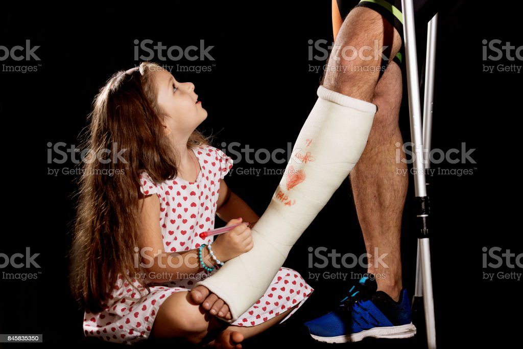 A little girl drawning on plaster cast stock photo