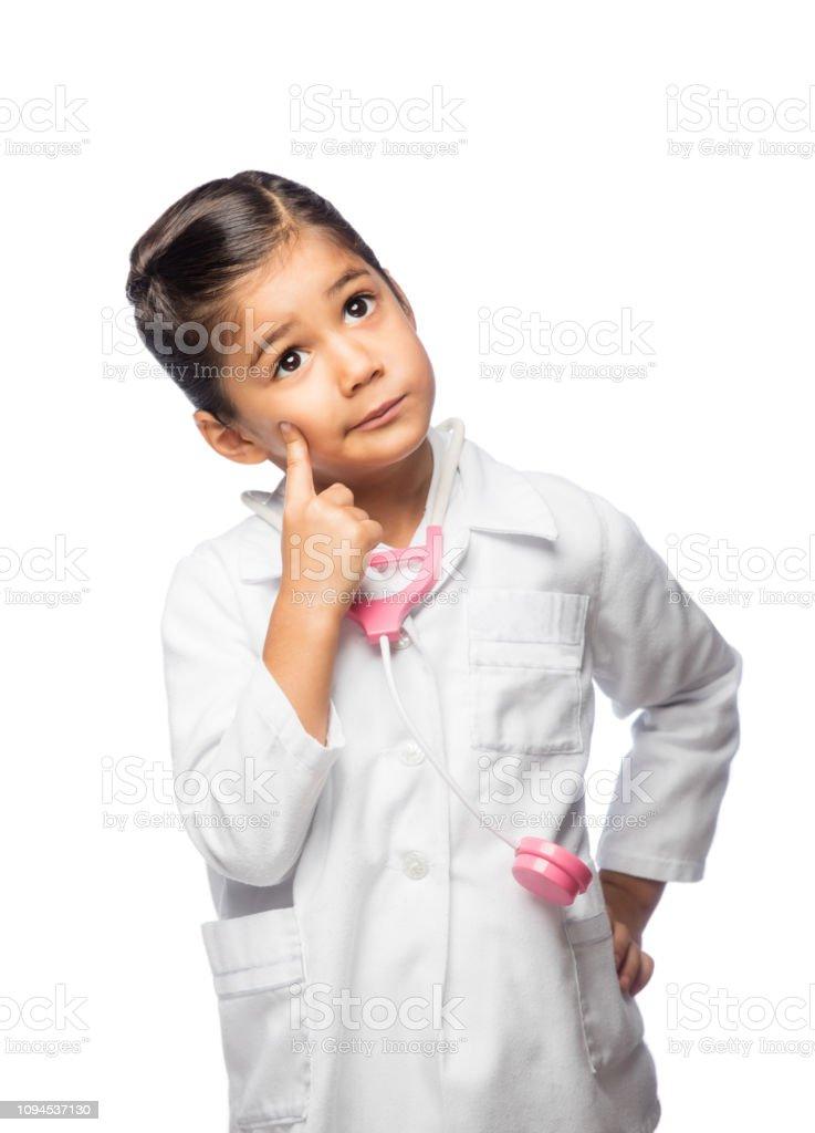 Little girl dress up like a doctor stock photo