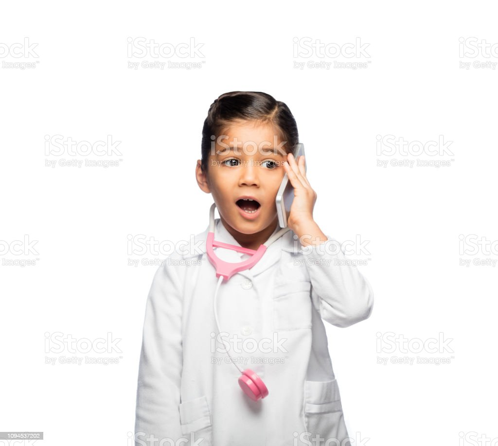 Little girl dress up like doctor talking on a cellphone stock photo