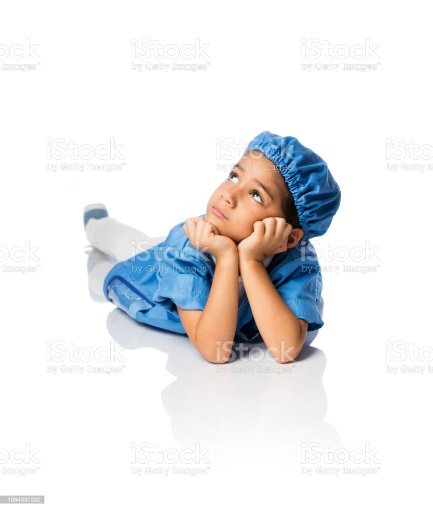 Little girl dress up like veterinarian looking up stock photo
