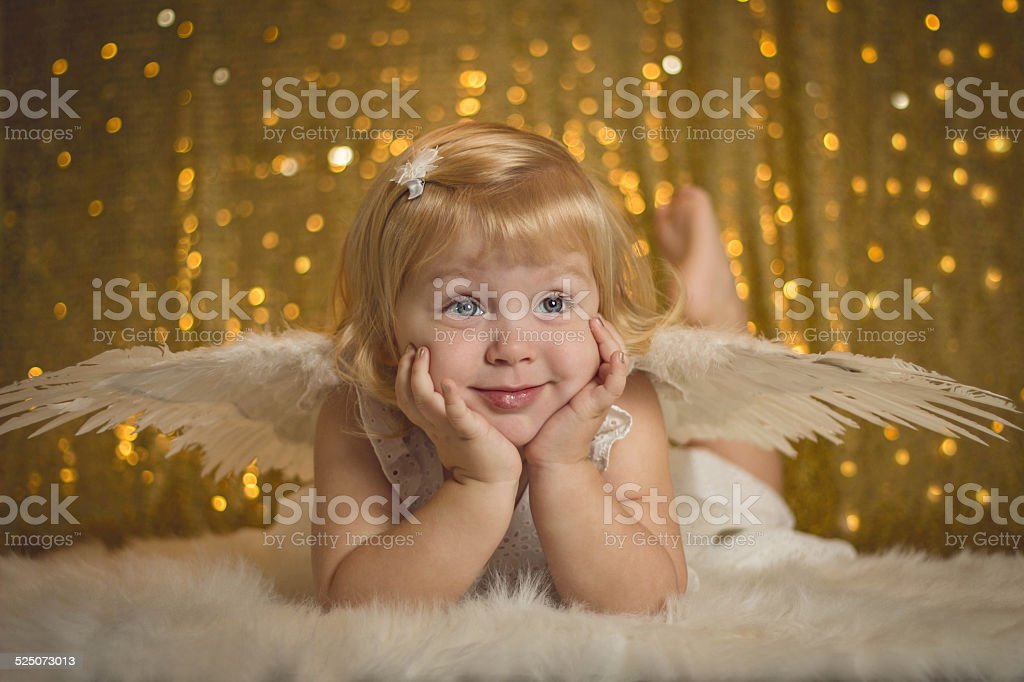 little girl dressed as an angel stock photo