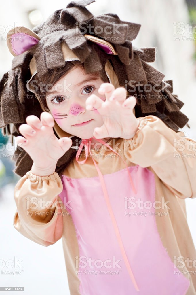 A little girl dressed up as a lion royalty-free stock photo