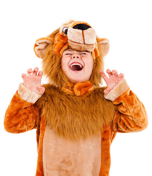 a little girl dressed up in a lion costume - mask disguise stock photos and pictures