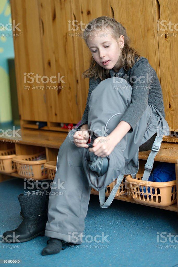 Little girl dressing up in kindergarten. Lizenzfreies stock-foto