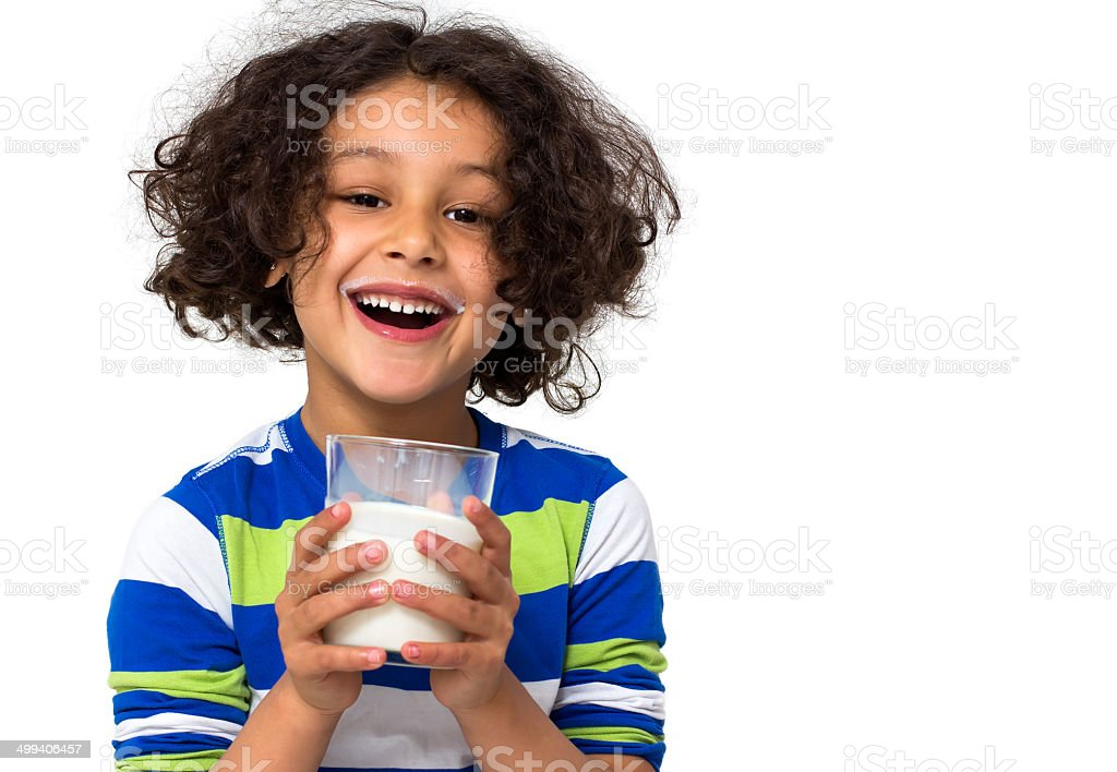 Little girl drinking a glass of milk stock photo